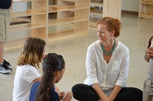 A teacher chats with students at Cypress Junction Montessori. CJM is currently accepting applications for enrollment.