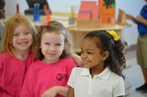 Three kindergarteners enjoy their day at Cypress Junction Montessori.